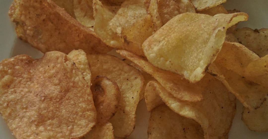 An image of crisps on a plate