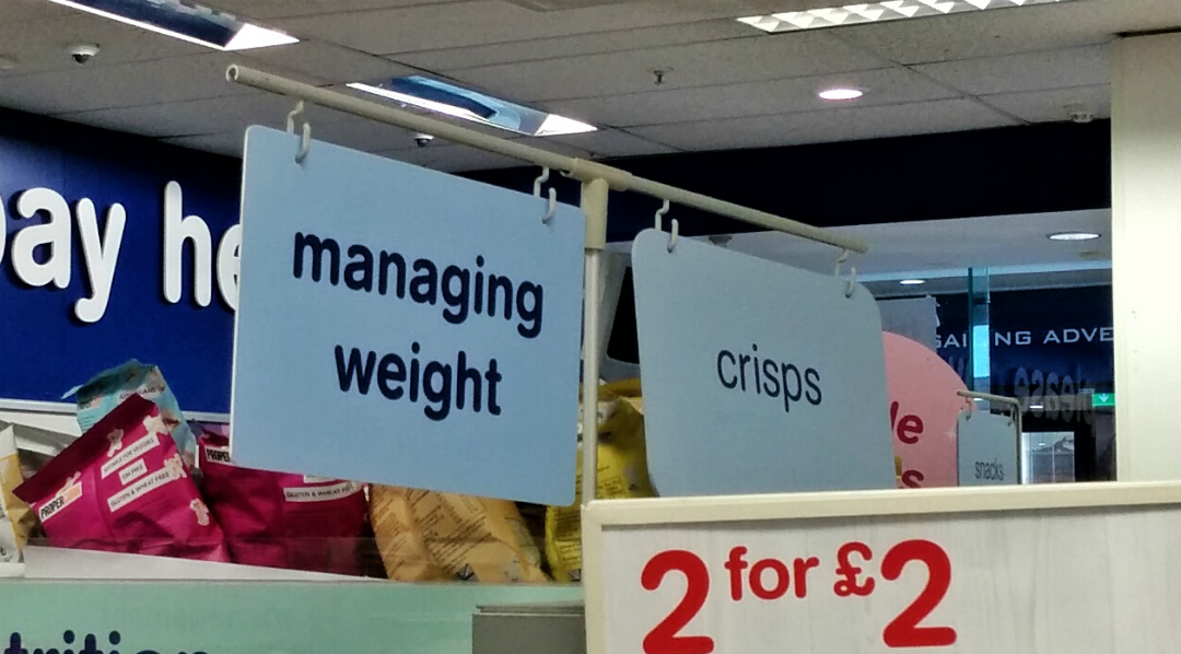 Products for managing weight are found nex to crisps.