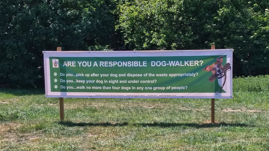A banner erected in Wimbledon Common, asking visitors whether they are responsible dog-walkers or not.