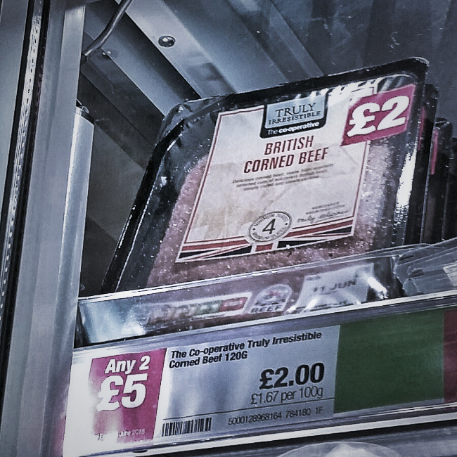 Silly supermarket offers. A pack of corned beef priced at £2, two packs for £5.