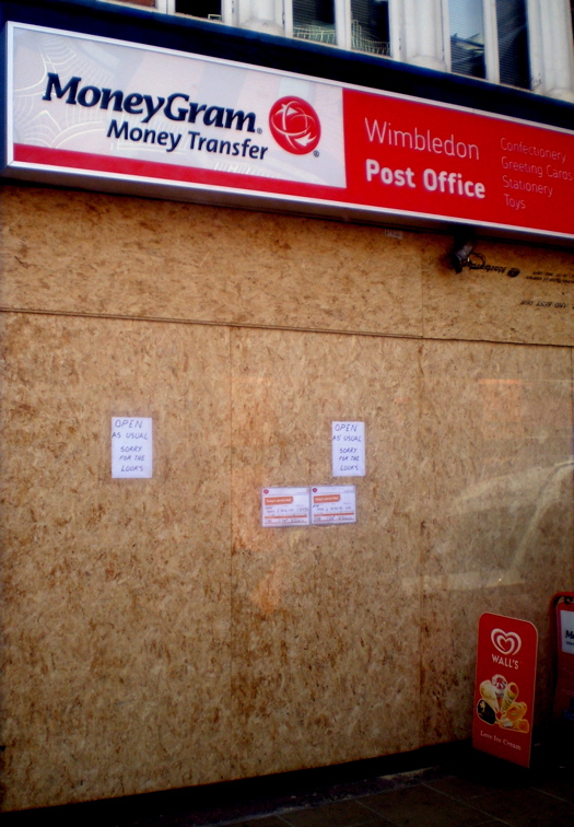 Wimbledon, 10 August 2011: A shop was boarded up, most likely as a precautionary measure
