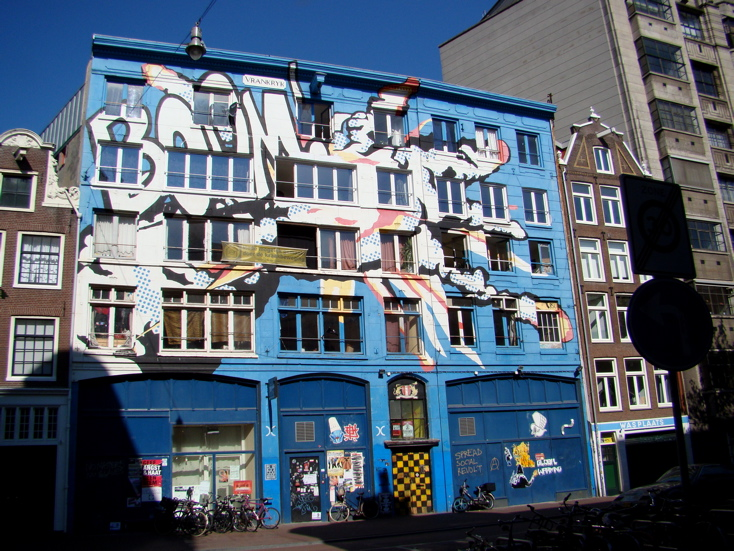 Photograph of a building covered in graffiti / art on Spuistraat in Amsterdam. (27 June 2010)