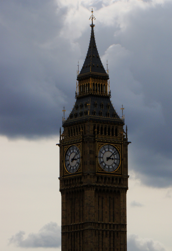 The Elizabeth Tower (the Clock Tower) of the Palace of Westminster, agianst the backdrop of blue sky.