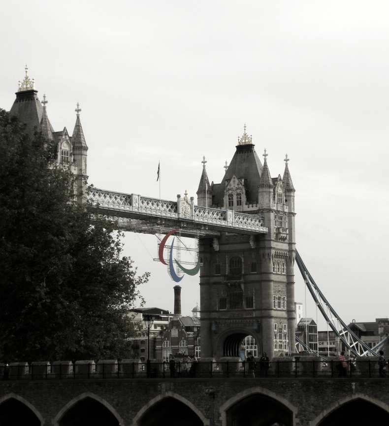 A photograph of Tower Bridge with the three Agitos, the symbols of the Paralympic Games