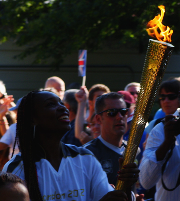 Venus Williams carrying the torch outside the Wimbledon tennis courts