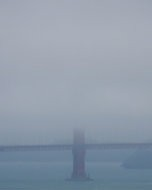 (Thumbnail) A tower of the Golden Gate Bridge covered in fog